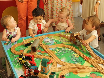 Babies with train set